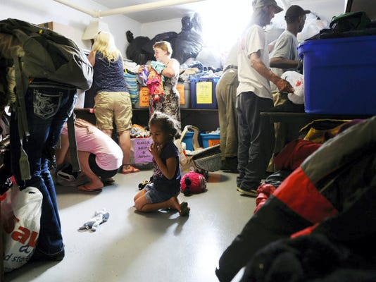 People look through sorted clothes at The First Church of God in York. The Zion Project collects food and clothing for those in need and opens church doors every other Friday 5:30 to 7:30 p.m. to serve those in need. The next one will be Friday, May 22.