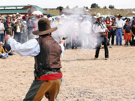 Courtesy photo   Gunfight re-enactments by Flying Cloud Productions are a popular attraction at Cowboy Days at the New Mexico Farm & Ranch Heritage Museum.