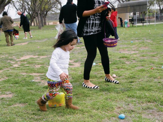 SARAH MATOTT - CURRENT-ARGUS   One-year old, Brielle Bird, particpated in the egg hunt for the first time Saturday, and easily had her basket filled with easter eggs. The Bunny Hop Egg Hunt was Saturday at the Carlsbad Beach Park and was sponsored by New Mexico State University Carlsbad.