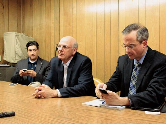U.S. Rep. Steve Pearce sits with Outreach Director Peter R. Ibarbo and Communications Director Tom Intorcio as he speaks about funding issues with the military and other issues facing New Mexico.