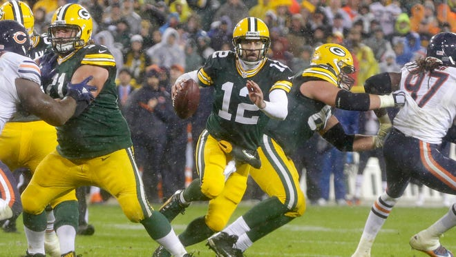 Aaron Rodgers scrambles during the Packers' 17-13 Thanksgiving Day loss against the Chicago Bears last year at Lambeau Field.