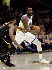 Golden State Warriors' Draymond Green is defended by Cleveland Cavaliers' Tristan Thompson in the first half of Game 4 of basketball's NBA Finals, Friday, June 8, 2018, in Cleveland. (AP Photo/Tony Dejak)