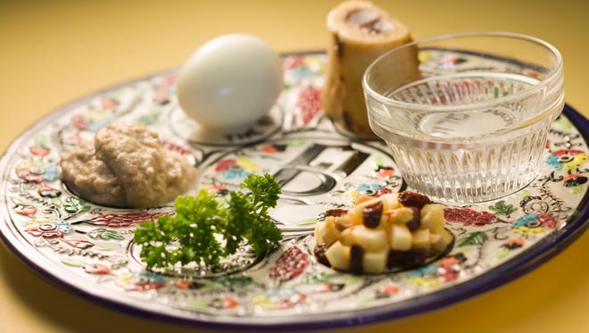 A traditional Passover seder plate is shown.