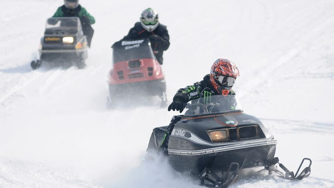 It takes a lot of work by volunteers to keep Wisconsin's 22,000 miles of snowmobile trails open each year.