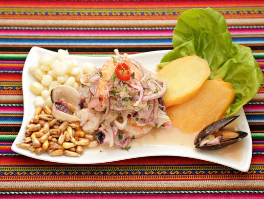 Ceviche mixto at El Chullo Peruvian Restaurant is a heap of lime- and chile-accented seafood with red onion alongside sweet-potato slices and chewy corn kernels.