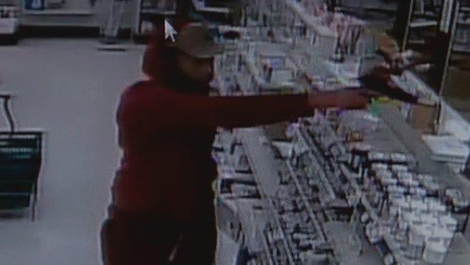 Image from surveillance video at Village Pharmacy in Harrison Township on Wednesday.
