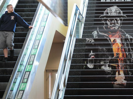 Firefighting art can be seen around the Indiana Convention Center, including this display on the risers of steps inside the building.