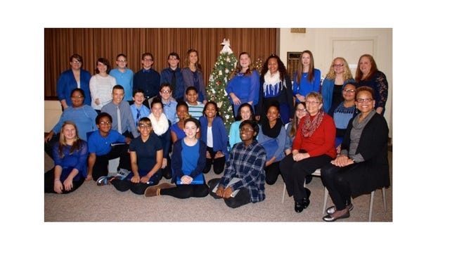 The Millville Woman's Club held its annual Tree of Remembrance Ceremony on Dec. 7 led by Barbara Westog (seated, second from right). Sharon Mosley (seated at right) sang beautifully and then Shades of Blue Choir from Lakeside Middle School performed. Shari Booz (back row, far right) leads the choir. Proceeds from this event benefit a scholarship for a female student at Millville Senior High School.