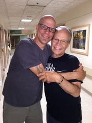 Tommy Velline and Bobby Vee share a hug during a late
