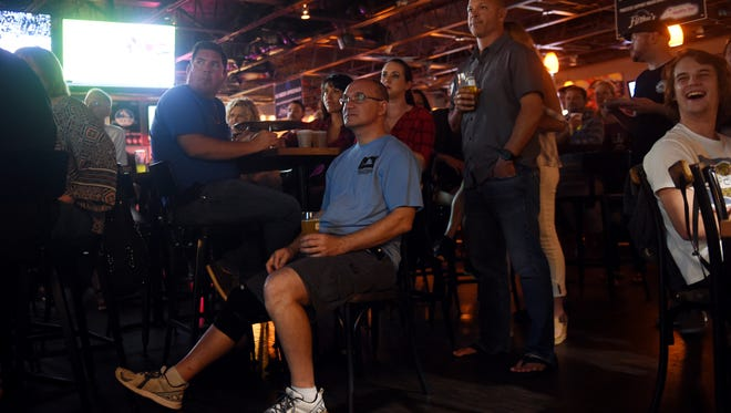 """Beer enthusiasts gather at Filthy's Fine Cocktails & Beer in Vero Beach on Thursday, Dec. 28, 2017, to watch a special screening of """"Beerland"""", a TV show about travel and beer on the Viceland channel. The newest episode features a pair of Indian River County Ocean Rescue lifeguards and homebrewers, Michael Flinn and Johnathan Billings. Although the show features just Billings and Flinn, they're part of Red Buoy Brewers with Eric Carson, Willie Boscovich and Jason Flinn, Michael's brother. All but one live in Sebastian, and all but one have been lifeguards."""