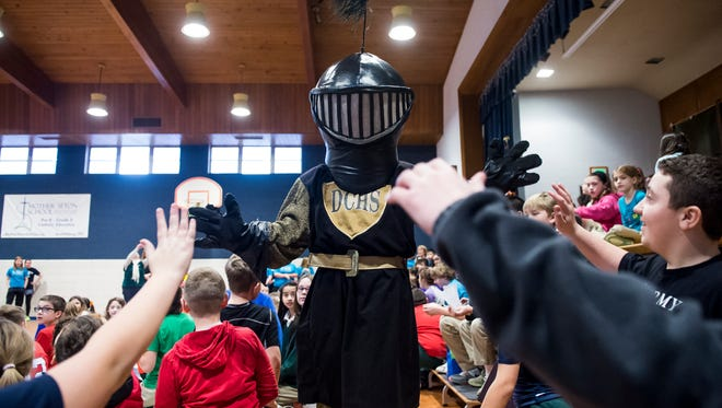 The Delone Catholic Squires mascot greets students at Mother Seton School in Emmitsburg, Maryland on Feb. 1, 2018. The school held its ninth annual Have-A-Heart Volleyball game to benefit friends of the school who are fighting cancer. Some of the money raised will go to Delone Catholic senior Tommy Laudani, an MSS '14 alum who has been battling cancer since 2016.