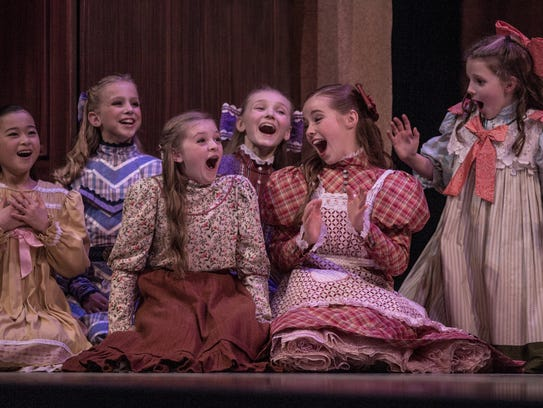 """Trista Brantley, in the floral top and red skirt, played a party girl in The Nashville Ballet's 2014 edition of """"Nashville's Nutcracker"""" at TPAC."""