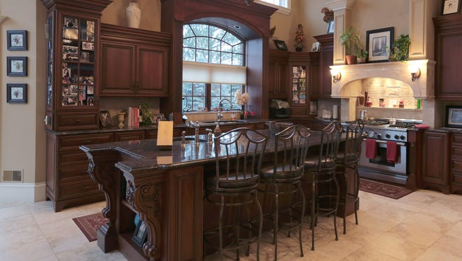 Large kitchen with granite counters and professional stove.