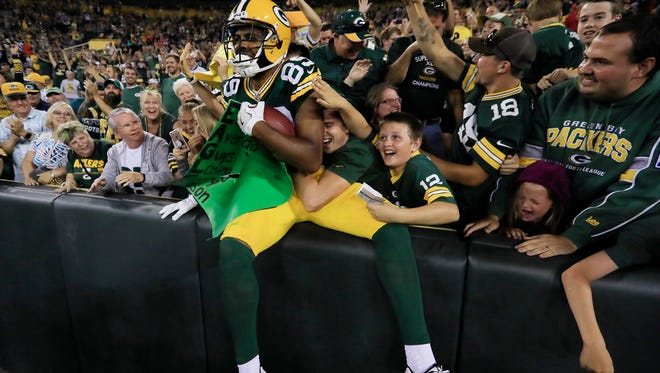 Green Bay Packers wide receiver Michael Clark (89) does a Lambeau Leap after scoring a touchdown in the fourth quarter on Thursday, Aug. 10, 2017, at Lambeau Field