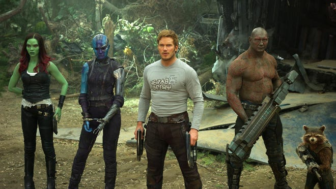 "Zoe Saldana, from left, Karen Gillan, Chris Pratt, Dave Bautista and Rocket (voiced by Bradley Cooper) appear in a scene from ""Guardians Of The Galaxy Vol. 2."""
