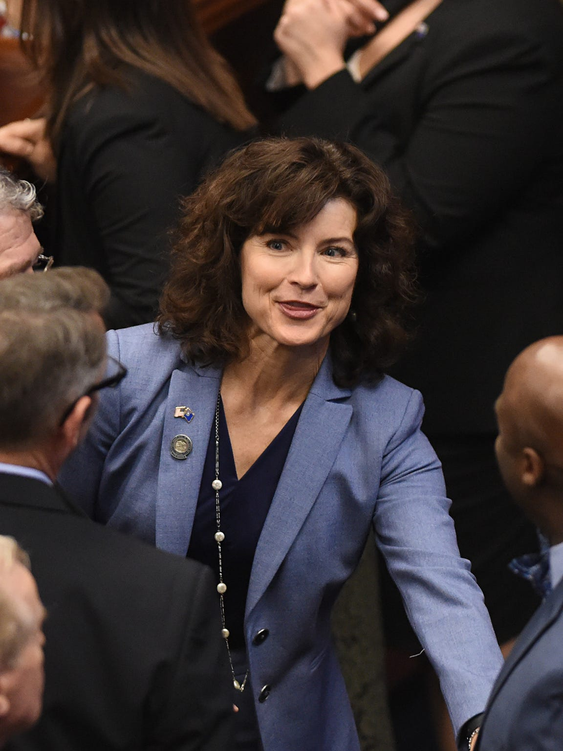 Senator Heidi Gansert walks the senate chambers as the 79th Session of the Nevada Legislature gets underway Feb. 6.