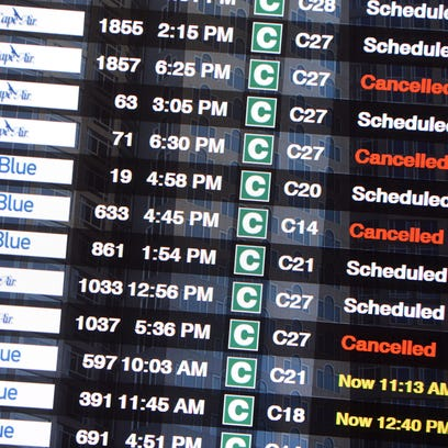 A flight board at Boston Logan airport shows cancellations on Jan. 26, 2015, ahead of a winter storm.