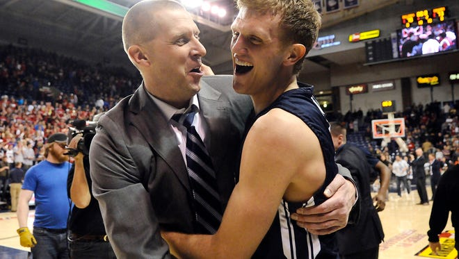 Feb 28, 2015; Spokane, WA, USA; Brigham Young Cougars guard Tyler Haws (3) celebrates with Brigham Young Cougars assistant coach Mark Pope (L) after their game against the Gonzaga Bulldogs at McCarthey Athletic Center. The Cougars won 73-70. Mandatory Credit: James Snook-USA TODAY Sports
