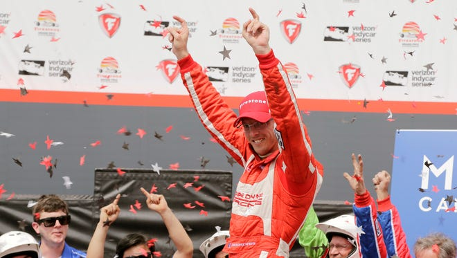 Sebastien Bourdais, of France, celebrates in Victory Lane after winning the IndyCar Firestone Grand Prix of St. Petersburg auto race Sunday, March 12, 2017, in St. Petersburg, Fla.