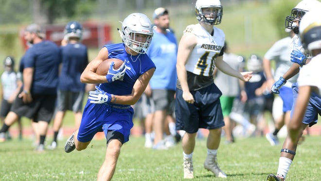 Smoky Mountain's Cody Lominac runs the ball during the FCA annual 7-on-7 tournament at Erwin High School on Thursday, July 13, 2017.