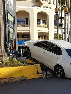 Police responded to a sedan crash on Pale San Vitores Road, Tumon, in front of Outrigger Guam Resort Christmas morning 2017.