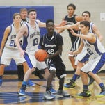 Royal Oak's tight defense causes Jordan Hogan to pass the ball out of the post.