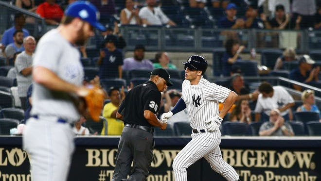 New York Yankees designated hitter Greg Bird (33) rounds the bases after hitting a solo home run as Kansas City Royals losing pitcher Brian Flynn (33) looks away during the eighth inning during game two of a doubleheader at Yankee Stadium.