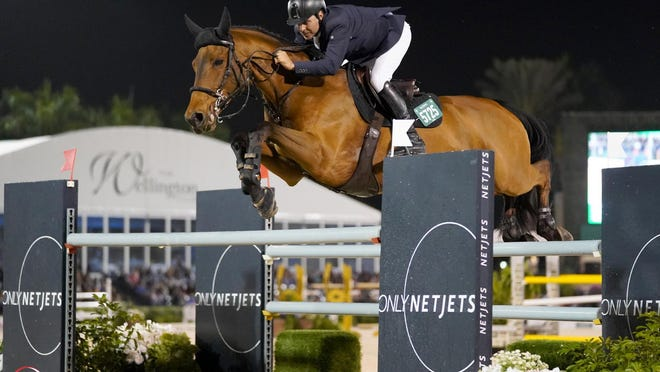 Santiago Lambre of Mexico and Cetano van Aspergem Z won a six-rider jumpoff Saturday night at the Palm Beach International Equestrian Center to capture the NetJets Grand Prix CS12.  [sportfot].