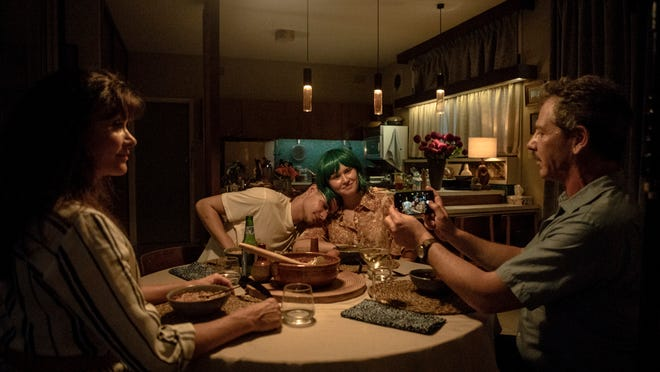 Anna, Moses, Milla, and Henry try to have a normal family meal together.
