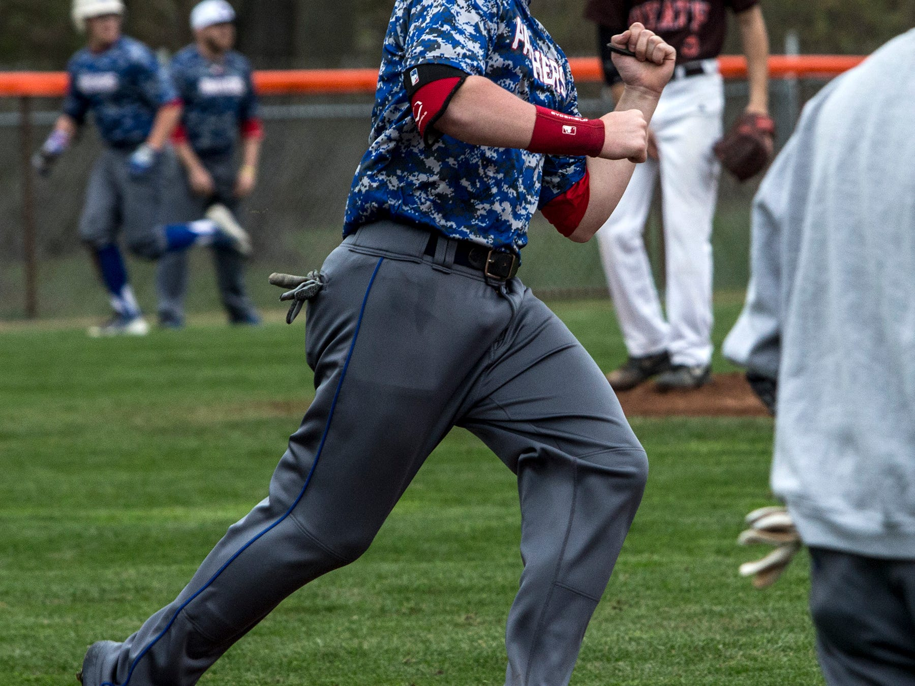 Jacob Dennis hits a three-run homer in Thursday's game against Heath. The game was suspended in the fifth inning because of rain, with the score tied 4-4.