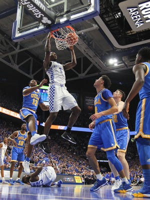 Kentucky's Bam Adebayo slams down two of his 18 points in the game against UCLA. He also had 13 rebounds, leading the Wildcats.