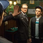 Colin Firth, left, introduces Taron Egerton to a whole new world in Kingsman: The Secret Service.