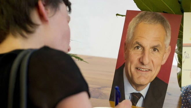 Signing a condolence book Saturday in Amsterdam for AIDS researcher Joep Lange, who was on the downed Malaysian jet.