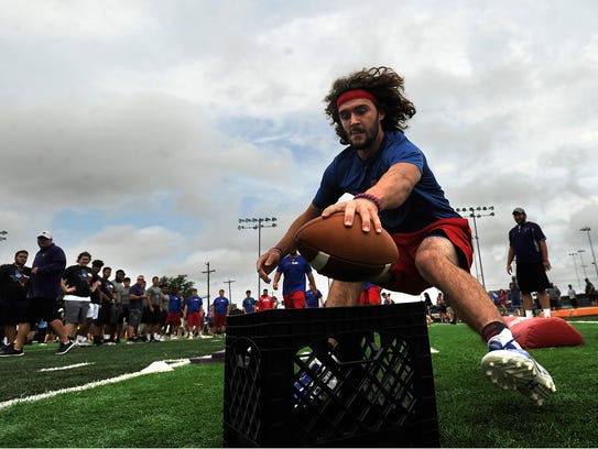 Cooper's Nick Powell drops a football in a basket while competing in the obstacle course during the fourth annual State LineMAN Challenge on  June 24 at Hardin-Simmons' University's Shelton Stadium. On Monday, the fullback and linebacker announced his decision to walk-on at Abilene Christian University.