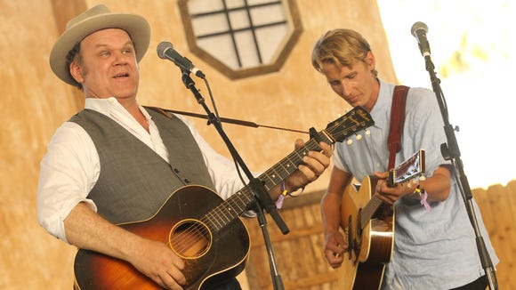 John C. Reilly and Tom Brosseau perform in 2013 at the Stagecoach festival in  Indio, Calif.