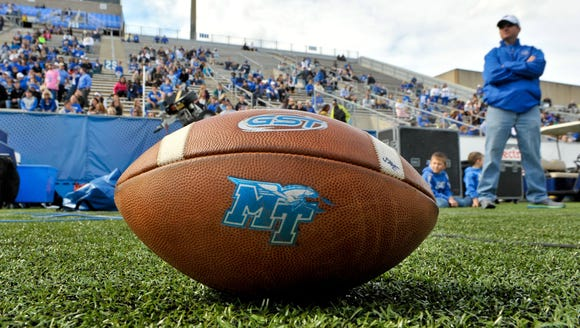 "A football at Floyd Stadium with the ""MT"" logo on it."