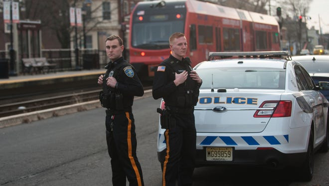 Burlington City police officers Cameron Lung (left) and David Edwardson jumped on the tracks as a River LINE train was approaching to keep it from hitting a little girl that was thrown on the tracks.