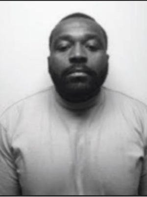 This photo taken in 2006 shows fugitive Antwan Tamon Mims, a convicted felon and known member of the Gangster Disciples, who is wanted by the FBI.