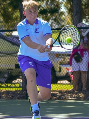 Pueblo Central's No. 3 singles Luke Johnson returns a shot against Mullen during the first round of the Class 4A state tournament Sept. 25, 2020, at Pueblo City Park.