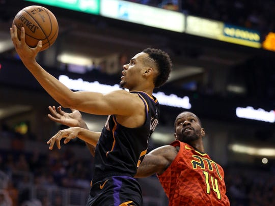 Suns rookie Elie Okobo drives past Hawks center Dewayne Dedmon during the first half of a game Feb. 2 at Talking Stick Resort Arena.
