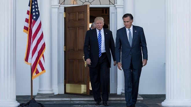 "President-elect Donald Trump and Mitt Romney leave the clubhouse after their meeting at Trump International Golf Club in this November 19, 2016, file photo. Romney said Friday he was ""sickened"" by President Donald Trump's dishonesty as described in Special Counsel Robert Mueller's report and ""appalled"" that people working for Trump's campaign welcomed help from Russia."