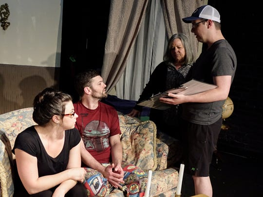 Director Gabe Ortego, right, discusses a scene with