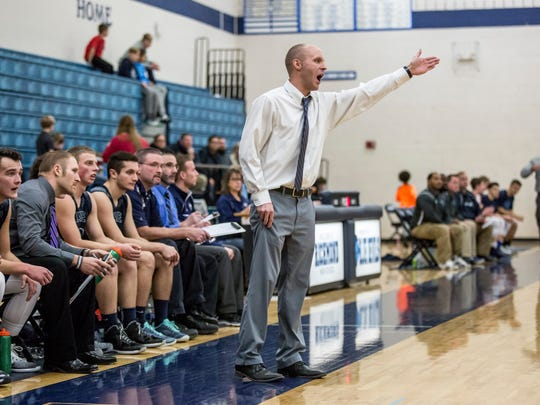 Yale coach Garnett Kohler yells to players from the bench during a basketball game Tuesday, Feb. 7, 2017 at Richmond High School.
