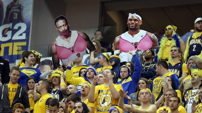 Indiana Pacers fans in the G2 Zone hold up their own Dwyane Wade and LeBron James  cut-outs in the second half of the Pacers' 90-84 victory over the Miami Heat on Dec. 10 at Bankers Life Fieldhouse.