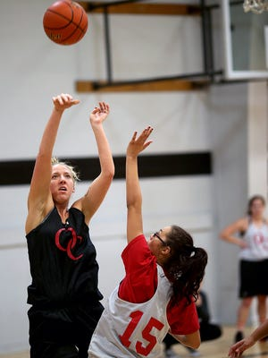 Olympic College women's basketball player Taylor Sunkel from South Kitsap shoots an outside jumper during practice.