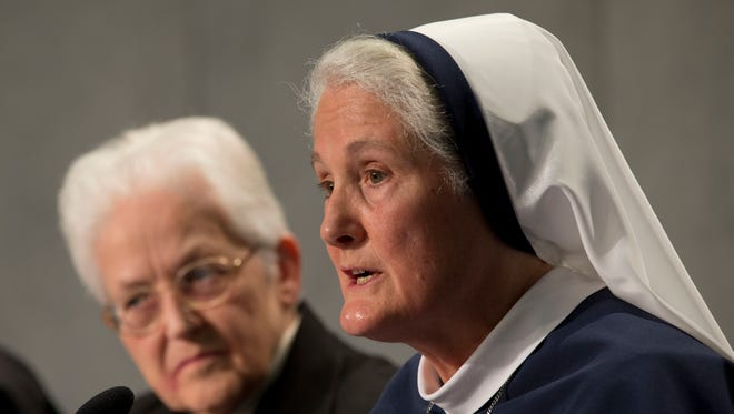 Sister Sharon Holland, left, and Mother Agnes Mary Donovan attend a press conference at the Vatican on Dec. 16, 2014.