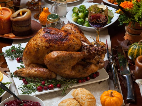 Turkey and other foods such as chicken, tofu and peanuts, contain the amino acid tryptophan which triggers chemicals in the brain to make use happy and sleepy.