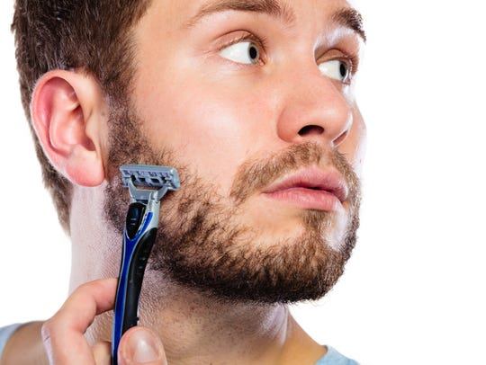 Man getting ready to shave his beard