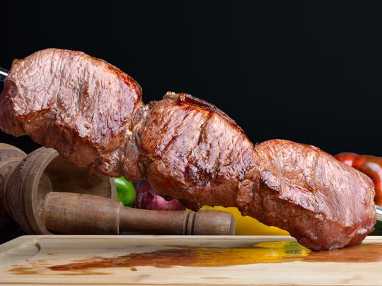 Skewered meats sliced tableside are hallmarks of Brazilian steakhouses.