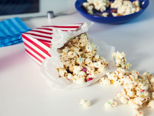 Consider illuminating your snacks table, and don't  forget the popcorn.